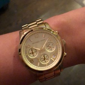 MK medium size gold watch